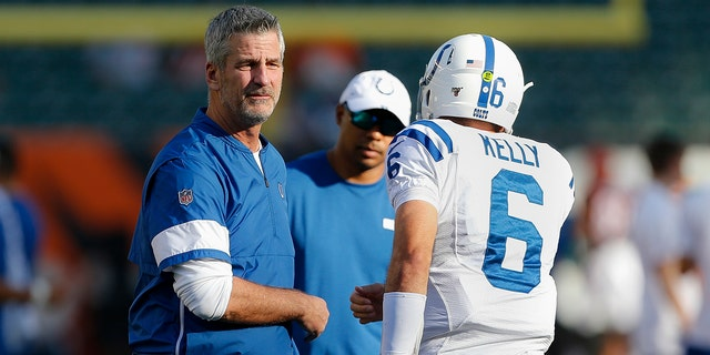 Indianapolis Colts coach Frank Reich, left, watches as players get ready for the team's NFL preseason football game against the Cincinnati Bengals, Thursday, Aug. 29, 2019, in Cincinnati. (AP Photo/Gary Landers)