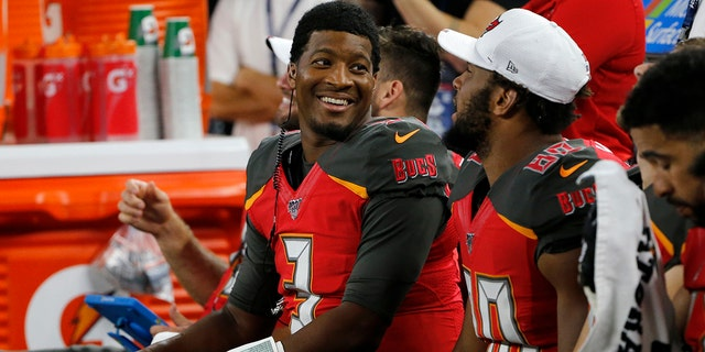 Tampa Bay Buccaneers quarterback Jameis Winston, left, talks with tight end O.J. Howard, right, on the sideline in the second half of a preseason NFL football game against the Dallas Cowboys in Arlington, Texas, Thursday, Aug. 29, 2019. (AP Photo/Michael Ainsworth)