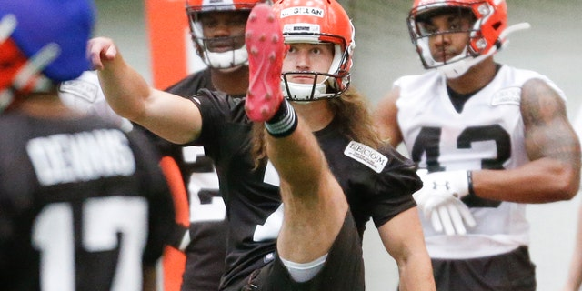 Cleveland Browns punter Jamie Gillan runs through a special teams drill during an NFL football rookie camp in Berea, Ohio. (AP Photo/Ron Schwane, File)