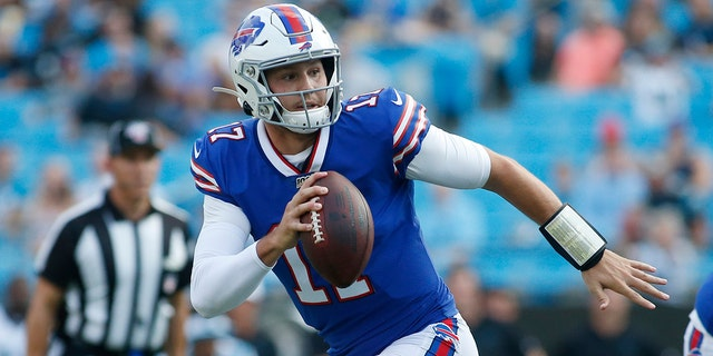 In this Aug. 16, 2019, file photo, Buffalo Bills quarterback Josh Allen (17) runs out of the pocket against the Carolina Panthers during the first half an NFL preseason football game, in Charlotte, N.C. (AP Photo/Brian Blanco, File)