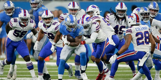Detroit Lions running back Ty Johnson (38) is pursued by the Buffalo Bills' defense during the first half of an NFL preseason football game in Detroit, on Aug. 23, 2019. (AP Photo/Duane Burleson)