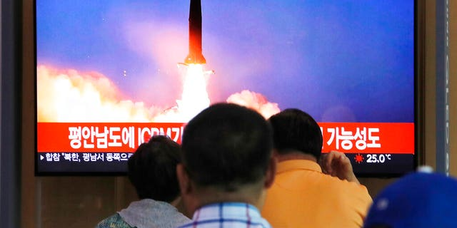 People watch a TV showing a file image of a North Korea's missile launch during a news program at the Seoul Railway Station in Seoul, South Korea, Tuesday, Sept. 10, 2019. (AP Photo/Ahn Young-joon)