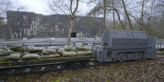 A train is shown outside the Blockhaus at the Nazi base Kraftwerk Nord West in northern France. (Science Channel)