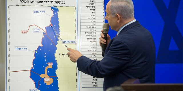 Israeli Prime Minister Benjamin Netanyahu points to a map of the Jordan Valley during his announcement on Tuesday in Ramat Gan, Israel .Netanyahu pledges to the Jordan Valley annex Occupied West Bank to react after the Sept. 17 Israeli elections. (Getty Images)