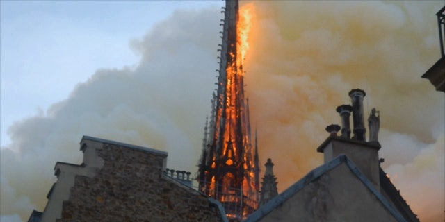 Notre Dame's famous spire before it toppled in the fire. (Science Channel)