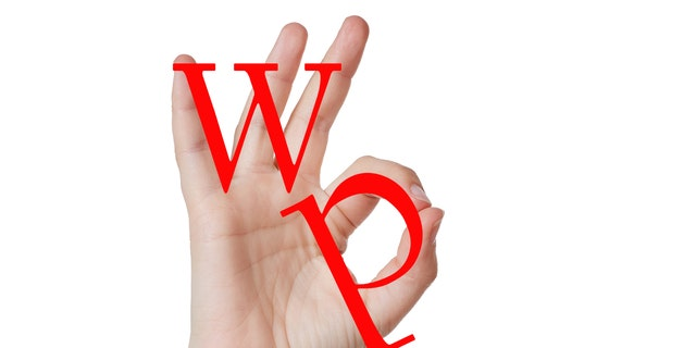 """The ADL has updated its database to include the """"OK"""" hand symbol, which became fodder for a 4chan trolling campaign to dupe viewers into thinking the fingers formed the letters """"W″ and """"P″ to mean """"white power."""" But the ADL says extremists also are using it as a sincere expression of white supremacy. (FILE)"""