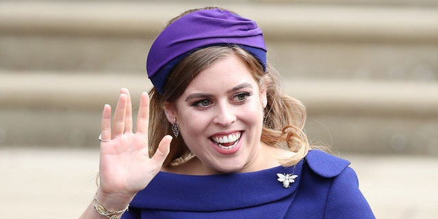 Princess Beatrice arrives for the wedding of Princess Eugenie to Jack Brooksbank at St George's Chapel in Windsor Castle.