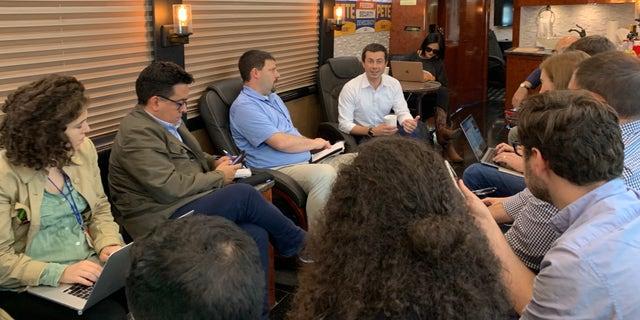 Pete Buttigieg talks with reporters during his four-day bus tour throughout eastern Iowa. (Mitti Hicks/Fox News)