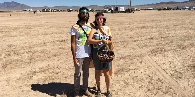 "Shahram Akhavan and Zoe Vidgoff at the third day of ""Alienstock"" in Rachel, Nev."