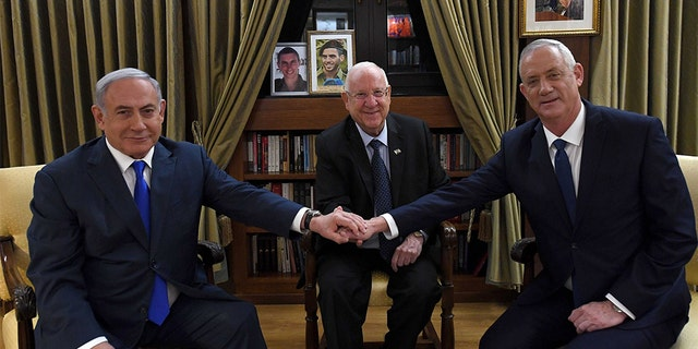 After a meeting with Israel's President Reuven Rivlin, center, Prime Minister Benjamin Netanyahu, left, and Blue and White party leader Benny Gantzagreed to begin talks toward forming a unity government.