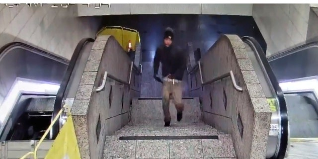 In this Friday night, Sept. 13, 2019, security camera video released by the Seattle Police Department, a suspect runs upstairs after a shooting at Westlake Station for Link light rail in Seattle.