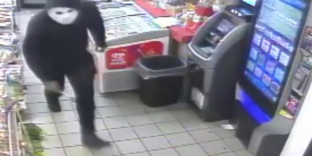 Philadelphia policewere looking for a man seen on surveillance video attacking a gas station worker with a hammer during a robbery, investigators said.