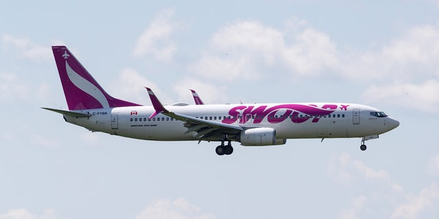 Canadian budget airline Swoop has apologized after a plane's engine caught on fire and forced an emergency landing just ten minutes after takeoff, due to a bird strike.