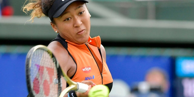 Japan's Naomi Osaka makes a forehand return to Russia's Anastasia Pavlyuchenkova during their final match at the Toray Pan Pacific Open tennis tournament in Osaka, western Japan, Sunday, Sept. 22, 2019. Osaka won her first singles title since the Australian Open in January by beating Pavlyuchenkova 6-2, 6-3 in the final. (Kyodo News via AP)