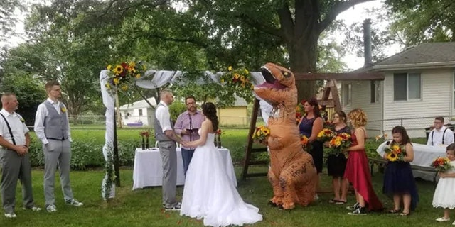 """It was hot!"" Meador said of wearing full-body costume to the outdoor August nuptials."