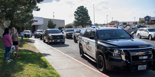 Odessa police officers parking their vehicles outside Music City Mall in Odessa, Texas, after the initial shots were fired Saturday.