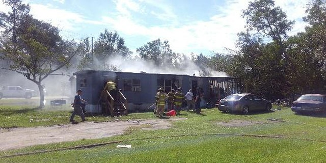 The mobile home was set ablaze Friday afternoon, according to police.