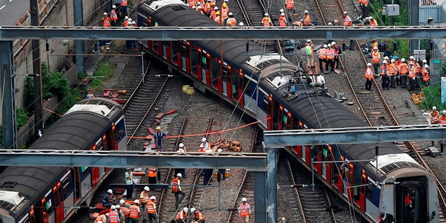 The train derailment in Hong Kong injured at least eight people. (REUTERS/Tyrone Siu)
