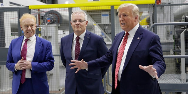 President Trump speaking as Australian Prime Minister Scott Morrison, center, and Pratt Industries chairman Anthony Pratt watched during a factory tour Sunday