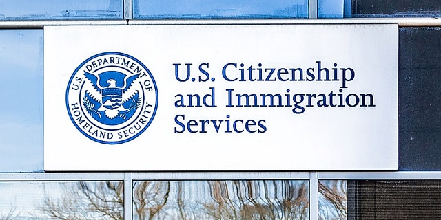 Fairfax: USCIS US United States Citizenship and Immigration Services field main office entrance in Virginia with sign -file photo.
