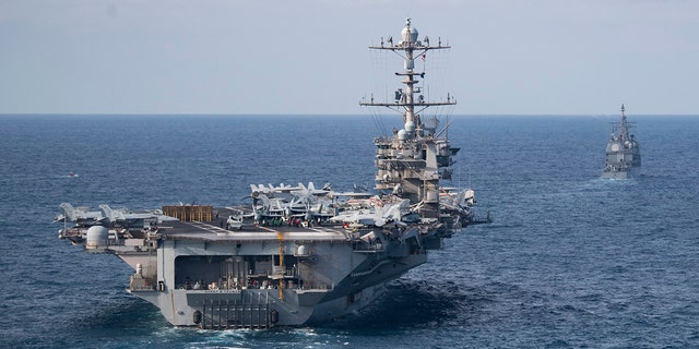 The Nimitz-class aircraft carrier USS Harry S. Truman, front, did not deploy last week with other ships in its strike group. (U.S. Navy/Mass Communication Specialist 2nd Class Scott Swofford)