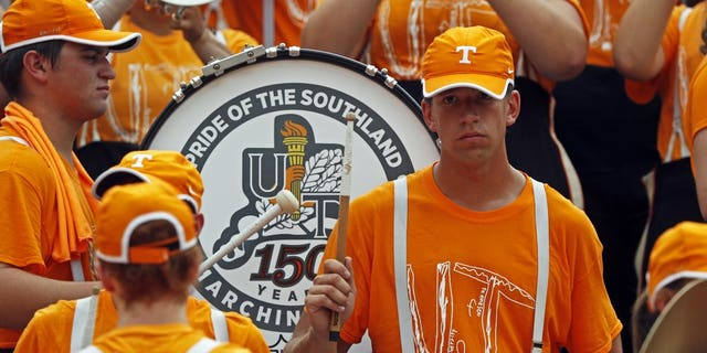 Members of the Pride of the Southland band perform as they wear the University of Tennessee superfan shirt after designing his own UT shirt and wearing it to his school before an NCAA college football game against Chattanooga Saturday, Sept. 14, 2019, in Knoxville, Tenn. (AP Photo/Wade Payne)