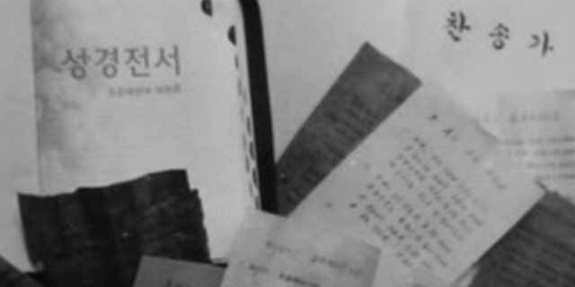 Christian materials shown in an North Korea government anti-religion training video.