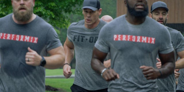 WWE star John Cena, center, said he and FitOps Foundation, sponsored through Performix, would match all donations until Veterans Day up to $1 million to help veterans returning from combat and keep them from committing suicide. FitOps was founded by Matt Hesse, the CEO of Performix and an Army veteran, far right. (FitOps Foundation)