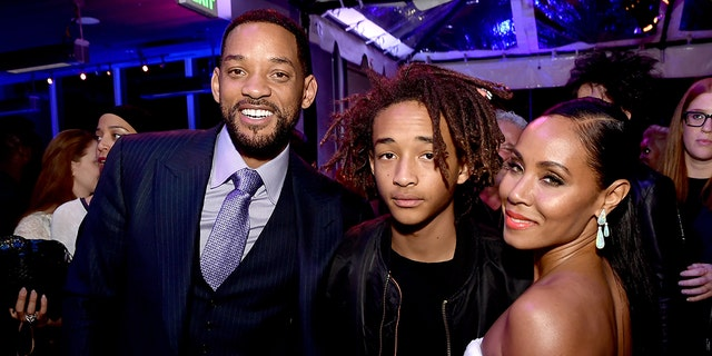Actors Will Smith, pictured here with son Jaden Smith and his wife Jada Pinkett Smith posted a video of his struggle to get pies home for Thanksgiving.