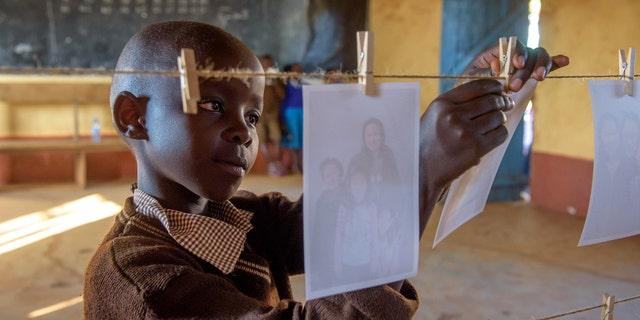 "Elizabeth Mueke Kitonga looks for her sponsor as part of World Vision's ""Chosen: Mwala Sponsorship Event."""