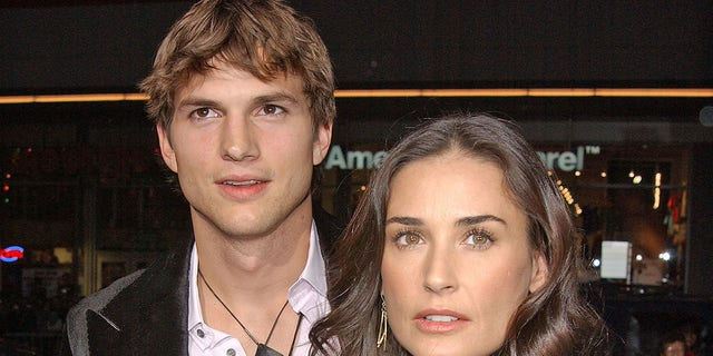 """Ashton Kutcher and Demi Moore during """"Guess Who"""" Los Angeles Premiere - Arrivals at Grauman's Chinese Theater in Hollywood."""