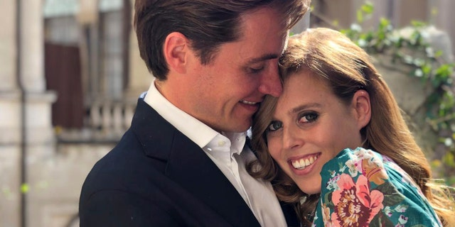 This undated photo released by Buckingham Palace shows Britain's Princess Beatrice and Edoardo Mapelli Mozzi, in Italy. Prince Andrew and his former wife Sarah Ferguson announced on Thursday, Sept. 25, 2019, the engagement of their elder daughter, Princess Beatrice to Edoardo Mapelli Mozzi.