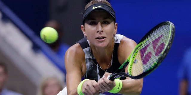 Belinda Bencic, of Switzerland, returns to Naomi Osaka, of Japan, during the fourth round of the US Open tennis championships. (AP Photo/Frank Franklin II)