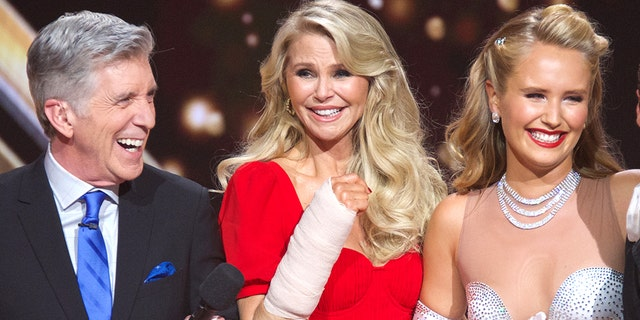 Christie Brinkley posing with her daughter and 'Dancing with the Stars' host Tom Bergeron at the Season 28 premiere.