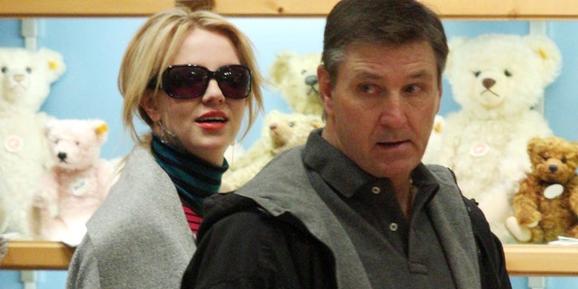 Britney Spears (left) with her father Jamie, who has served as her conservator and is accused of suppressing his daughter and stealing from her fortune. (Photo by Philip Ramey/Corbis via Getty Images)