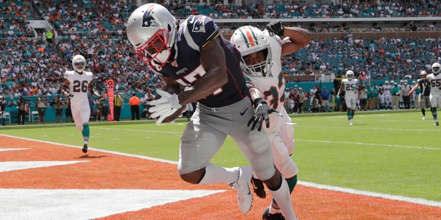 New England Patriots wide receiver Antonio Brown (17) scores a touchdown as Miami Dolphins cornerback Jomal Wiltz (33) attempts to defend on Sept. 15, in Miami Gardens, Fla. (AP Photo/Lynne Sladky)