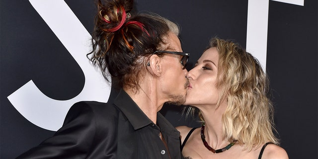 "Steven Tyler and Aimee Preston share a kiss at the premiere of ""Ad Astra"" at The Cinerama Dome on September 18, 2019 in Los Angeles, Calif. (Photo by Axelle/Bauer-Griffin/FilmMagic)"