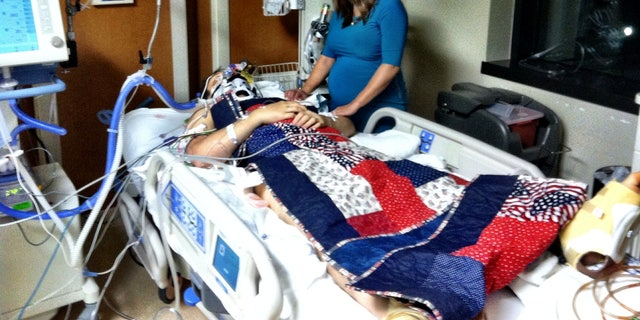 Captain Nathan Nelson and wife Jennifer on his road to recovery