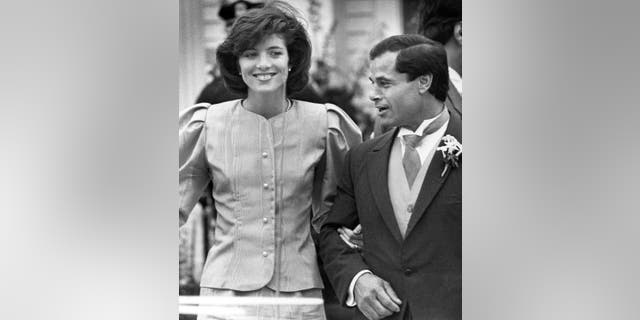 In this April 26, 1986, file photo, maid of Honor Caroline Kennedy and Best Man Franco Columbu leave St. Francis Xavier Church after the wedding of Caroline's cousin Maria Shriver to Arnold Schwarzenegger in Hyannis, Mass. Italian bodybuilder, boxer and actor Franco Columbu, one of Arnold Schwarzenegger's closest friends, has died aged 78. Columbu died in a hospital in his native Sardinia on Friday, Aug. 30, 2019 afternoon after being taken ill while he was swimming in the sea.