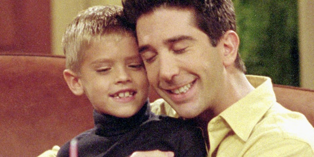 """Cole Sprouse as Ben Geller, left, and David Schwimmer as Ross Geller, right, in an episode of """"Friends"""" titled """"The One with the Holiday Armadillo."""" The episode aired on December 14, 2000."""