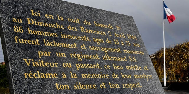 A commemorative plaque is placed in the village of Ascq, in northern France, to remember the April 1944 massacre of 86 people by Nazis.