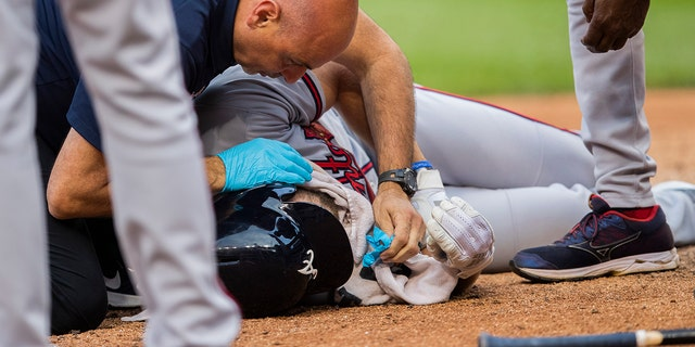 Culberson dropped to the ground after getting hit by a ball during the seventh inning. (AP Photo/Manuel Balce Ceneta)