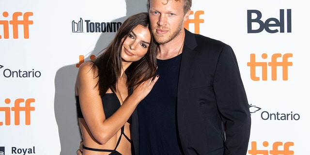"Actress Emily Ratajkowski, left, and producer Sebastian Bear-McClard attend a premiere for ""Uncut Gems"" on day five of the Toronto International Film Festival at the Princess of Wales Theatre on Monday, Sept. 9, 2019, in Toronto."