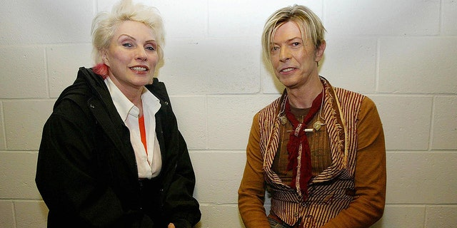 Debbie Harry chats with David Bowie before his concert as part of The Reality Tour at Manchester Evening News Arena in Manchester, England, on Nov. 17, 2003.