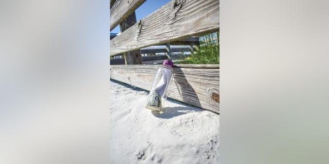 The bottle, which was cast into the waters on Aug. 1 from Destin, Fla., held notes, a small bag containing human ashes and four $1 bills.