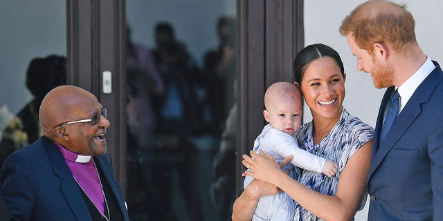 Britain's Duke and Duchess of Sussex, Prince Harry and his wife Meghan Markle hold their baby son Archie as they meet with Archbishop Desmond Tutu at the Tutu Legacy Foundation in Cape Town on Sep. 25, 2019. The British royal couple are on a 10-day tour of southern Africa -- their first official visit as a family since their son Archie was born in May.