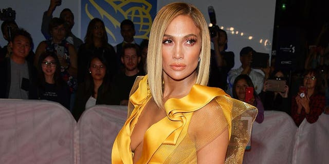 Jennifer Lopez carries a stack-of-cash clutch at the 'Hustlers' premiere