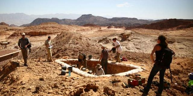 "Archaeologists excavate a copper production site dubbed ""Slaves' Hill"" in the Timna Valley, Israel."