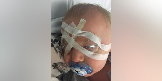 Theo Bennett is a picture of happiness and can now view the world around him in focus after his sight was saved by medics.