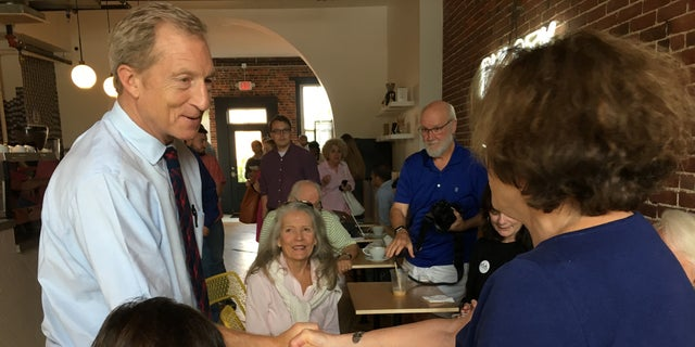 Democratic presidential candidate Tom Steyer greets voters during a campaign stop in Concord, NH on Thursday, Sept. 5, 2019